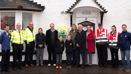 Somersham celebrated the unveiling of the new Community Defibrillator installed on the front of Tesc