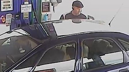 Police are looking to talk to this beret-wearing suspected fuel thief