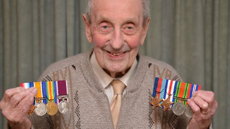 Vic Speers, from Brampton, with his war medals,