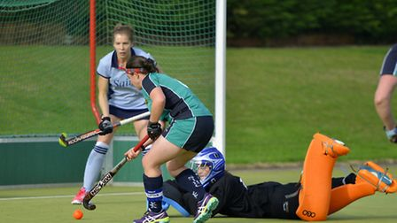 Helen Clarke scores the second goal for St Ives Ladies 1sts in their derby triumph against St Neots.