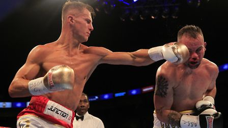 Tommy Martin lands a blow in his last fight against Michael Devine when winning the WBA Continental