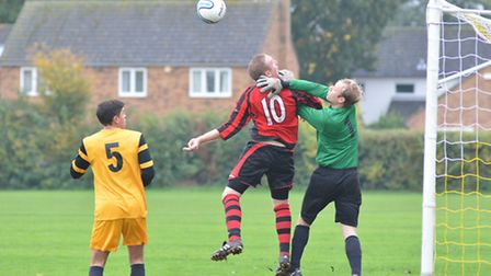 Goalkeeper Steve Large was the penalty shoot-out hero as Needingworth booked their place in the Hunt