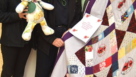 Co-Op St Ives, are fundraising for the poppy appeal, by raffling a poppy covered quilt, (l-r) Shop F