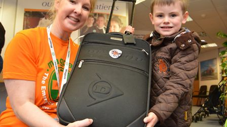 Suitcase sale at Magpas, Huntingdon, Fundraiser Coordinator Emma Sanders, and Zach Shiels, from Godm