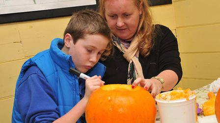 Ewan, 10 and Jo Bimpson have a go at pumpkin carving