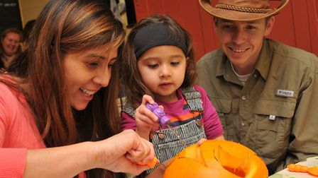 Belle, Penelope, 2 and Andy Pickering carve a pumpkin at the Wimpole estate