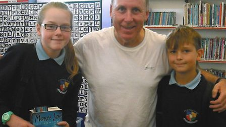 Author Peter Murray with St Peter's School pupils Leah Jones and Rafal Gasiul
