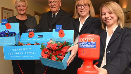 TL Cobbold, are co-ordinating this year's Poppy Appeal in St Neots, staff (l-r) Andrea Marr, Richard