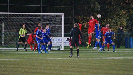 Tom Ward rises highest for St Neots Town during their Hunts Senior Cup success at Yaxley. Picture: G