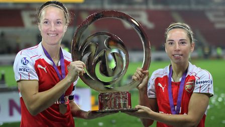 Former University of Hertfordshire student Jordan Nobbs (right) holds the Continental Cup aloft afte