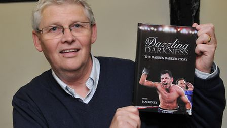 Author Ian Ridley with his book about boxer Darren Barker
