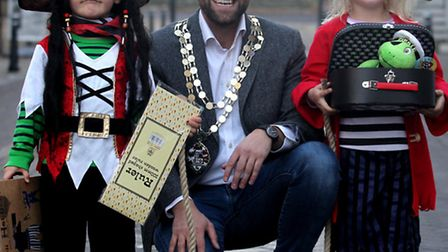 Mayor Ben Lewis, with pirate winner Alexander Williams and his twin Arabella.