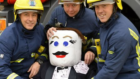 L-R Paul Greenhall, Greg Brown, and Leon Collins with the National Lottery guy