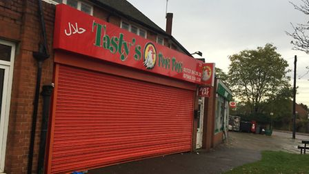 Tasty's Chicken & Pizza suffered damage to its frontage after a 30-strong altercation