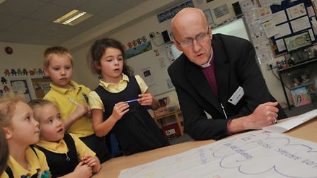 The Bishop of Hertford canon Michael Beasley pays a visit to a primary school class in the Samuel Ry