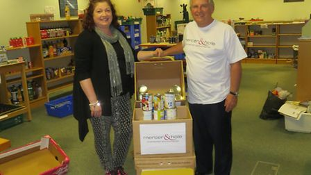 Emma Dalton, Operational Manager at St Albans & District Foodbank with Steve Smith, Partner at Merce