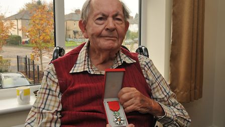 John Jenkins with his medal the Chevalier de la Legion d'Honneur which he was awarded by the French