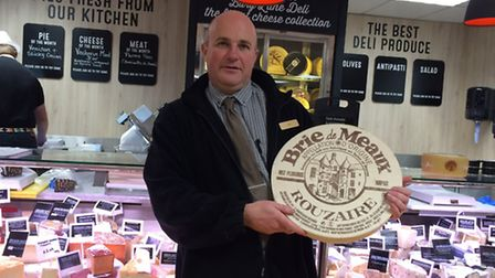 Ian Larkins next to the new cheese counter.