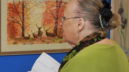Visitors admire the artwork at the Foxton art exhibition