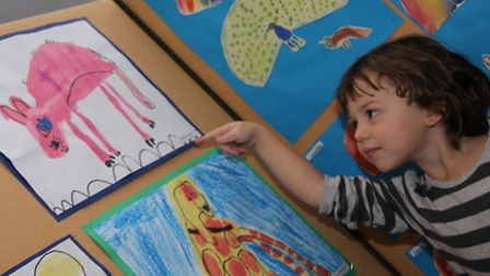 Martha Philips aged four points to her artwork. PICTURE: Clive Porter.
