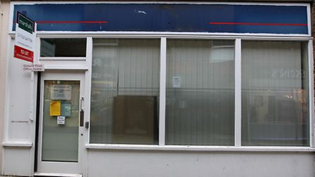 There is an application to change this empty office in Angel Pavement, Royston into housing