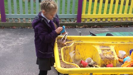 Reception pupils at Therfield First School using the outside area which was repainted by Tesco manag