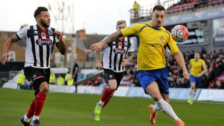 Louie Theophanous drives into the Grimsby half during Saints' FA Cup tie. Photo: LEIGH PAGE