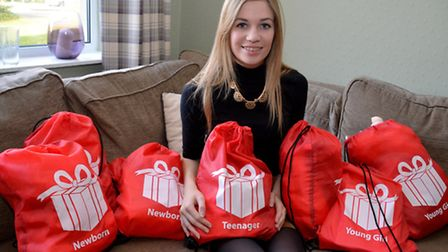 Olivia Beach with some of the charity bags