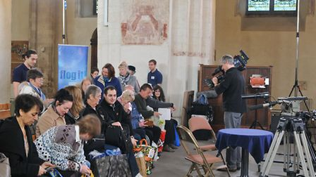 The BBC Flog It cameras film punters looking for valuations in St Albans Abbey