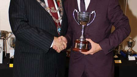 Tom Muir receiving the cup from club president, Peter Hubball