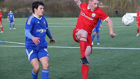 Jon Clements (in red) scored twice for Colney. Picture: JIM WHITTAMORE