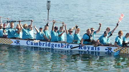 The Cambridgeshire Royals dragon boat team are celebrating promotion to the sport's Premier League.