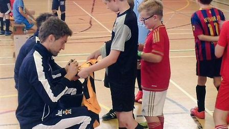 Youngsters meet their Cambridge United heroes at a previous Soccer School.