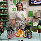 Oxfam volunteer Ellie Hale with the donations from Watford-star Ikechi Anya