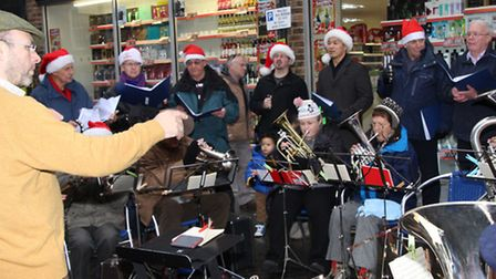 Royston Town Band entertain the crowds during Royston Christmas Fayre. PICTURE: Clive Porter.