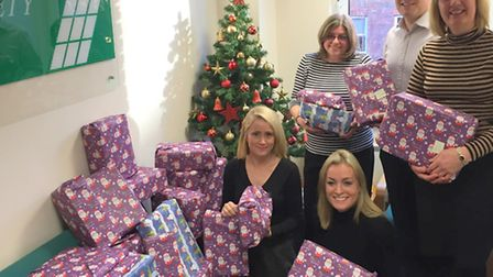 Members of the Aitchison Rafferty team, playing the role of Santa