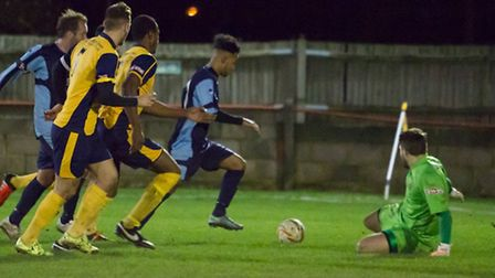 Isaac Galliford scores for St Neots in their 2-2 draw at Slough Town. Picture: CLAIRE HOWES