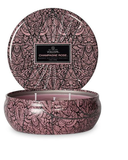 Triple wick candle in star embossed tin, Champagne Rose, £25, available from Voluspa (PA Photo/Hando