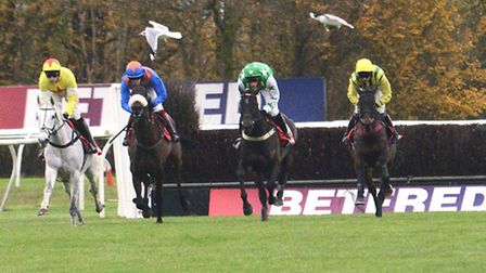 Al Ferof left) on the way to victory in the Peterborough Chase at Huntingdon Racecourse.