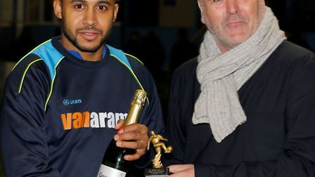 James Comley is presented with the Player of the Month award for November by Mick O'Shea, owner of t