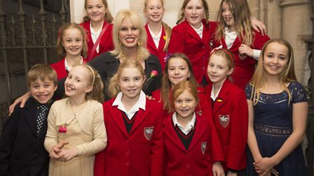 Joanna Lumley and girls attending Elizabeth's Legacy of Hope Carol Service at St Margarets Church,
