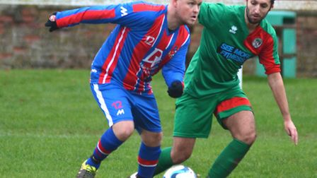 Action from Alconbury's derby draw against Huntingdon United. Picture: HELEN DRAKE