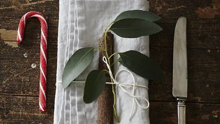 Even simple white linen napkins. like this one £20 from ALSO Home, can be made to look festive with