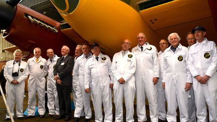 The de Havilland DH98 Mosquito with the team who refurbished her