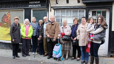 Members of the Save The High Street Campaign outside an empty shop.