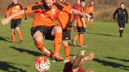 Dan Bisby of Stonewood Res is brought down by Marshalswick's Gary Hitchen for Stonewood's second pen