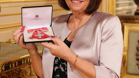 Chair of Governors for Alban City School, Linda Crawley, with her MBE. Photo courtesy of Richard Daw