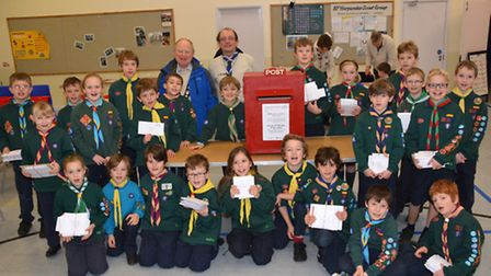 Town mayor Brian Ellis, vice president of Harpenden & Wheathampstead Scouts with Scouts who were sor