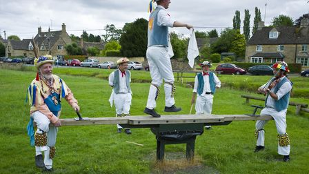 UNITED KINGDOM - JULY 24: Morris dancers, Icknield Way Morris Men, in children's playground at The