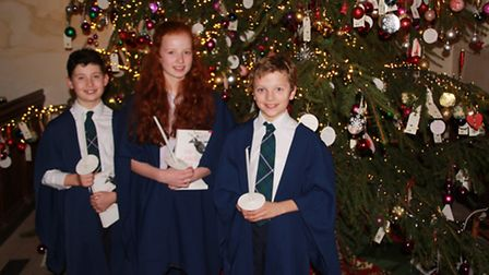 Thomas Scrope, Laura Barraclough, and William Hale with Christmas tree at the St. John the Baptist P